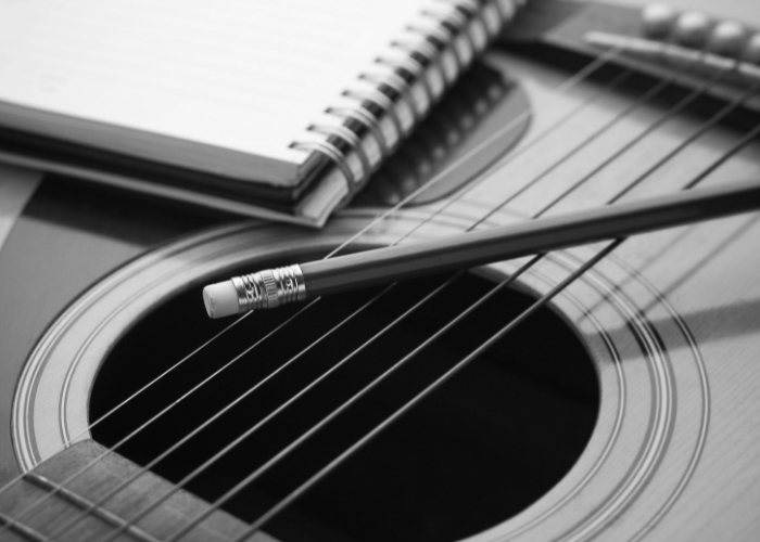 Guitar, notebook and pencil image
